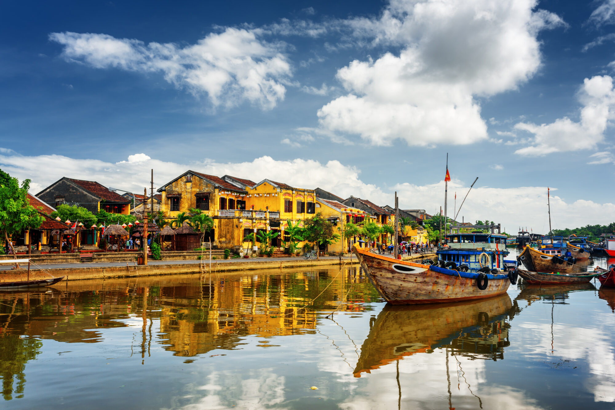 wooden boats in front of Hoi An in Vietnam