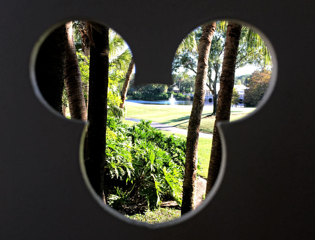 Silhouette of Mickey Mouse in a fence at Disney World.