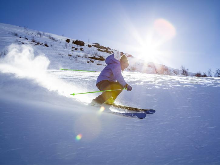 Skier going down slope