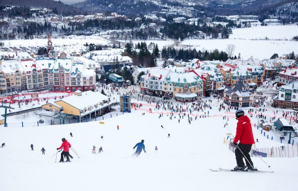 Skiers and snowboarders in Mont-Tremblant, Quebec.