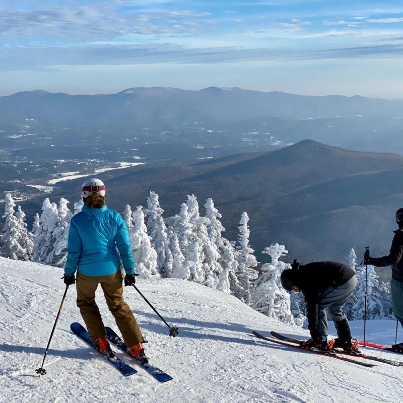 Skiers ar Stowe Mountain Ski resort Vermont.