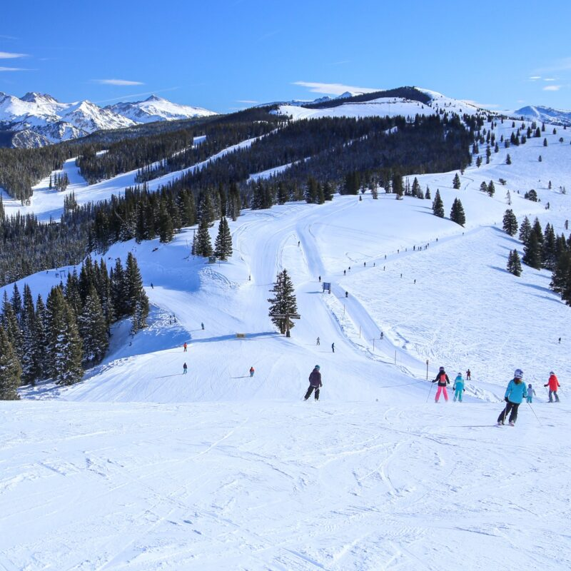 Skiers enjoying the slopes in Vail, Colorado.