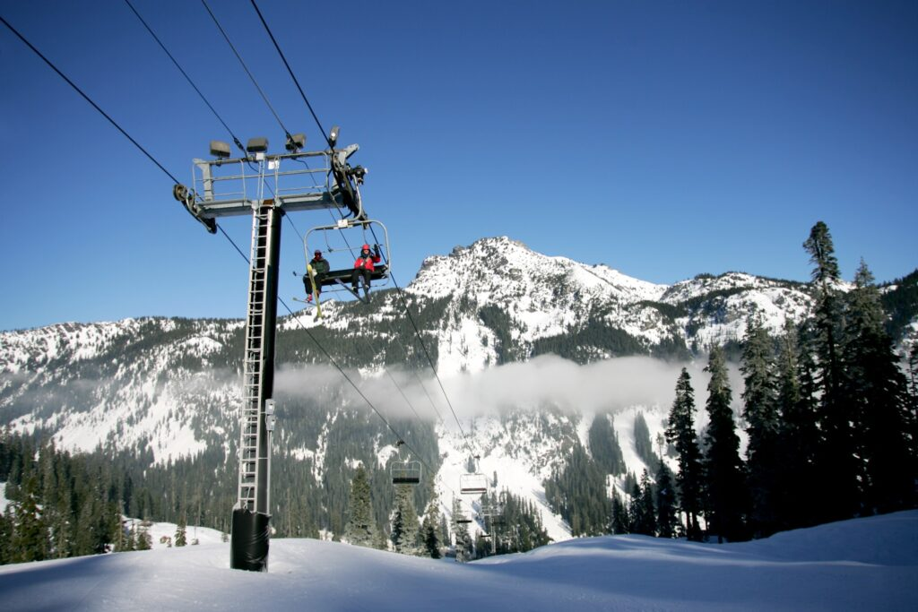 Skiiers on a lift in Snoqualmie Pass.