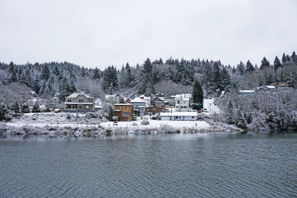 Snowy Astoria harbor during the winter.
