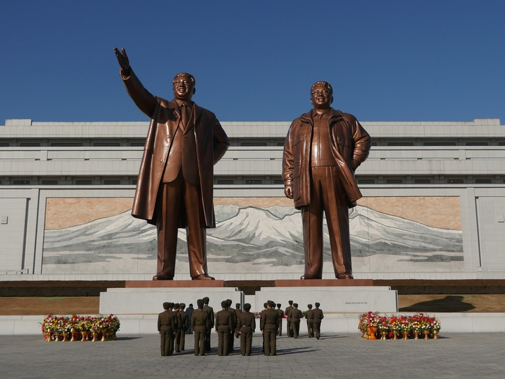 Soldiers observing huge bronze statues of Kim Il-sung and Kim Jong-il, Pyongyang, North Korea.