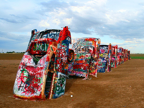 Spray painted cars sticking out of the ground, Cadillac Ranch, Texas.