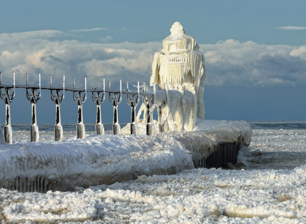 St. Joseph Lighthouse in Michigan, covered in frozen waves.