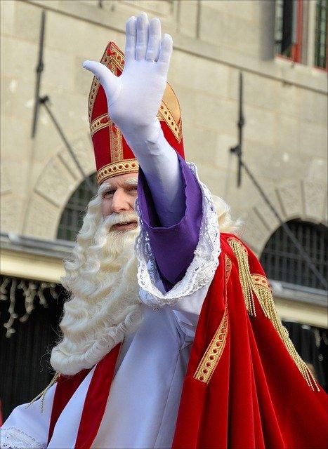 St. Nicholas costumed character waving