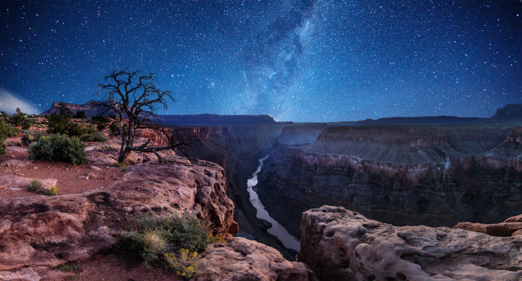 Stars shining above the Grand Canyon.