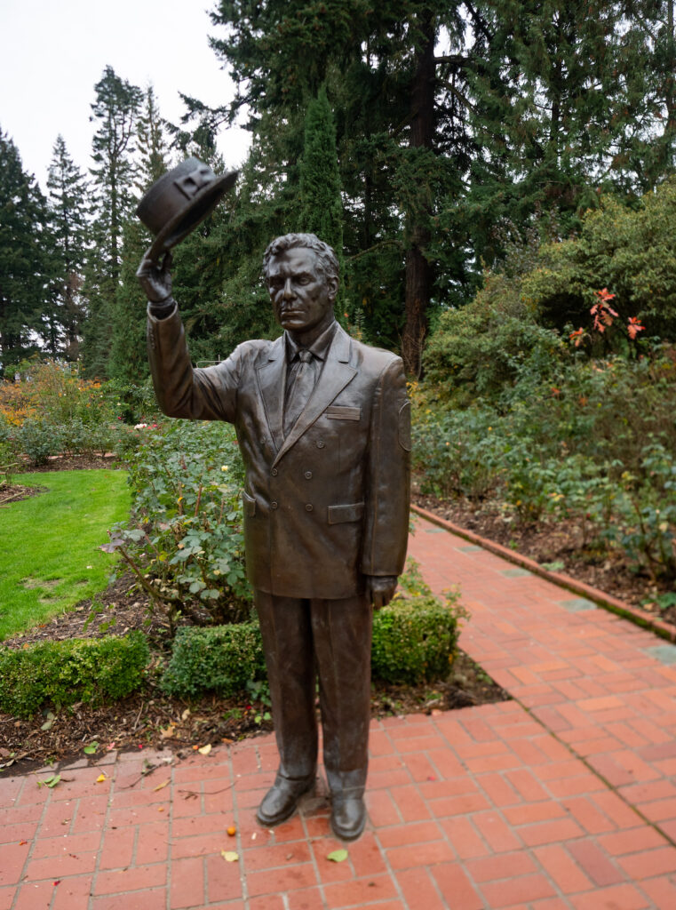 Statue of a Royal Rosarian at the International Rose Test Garden.