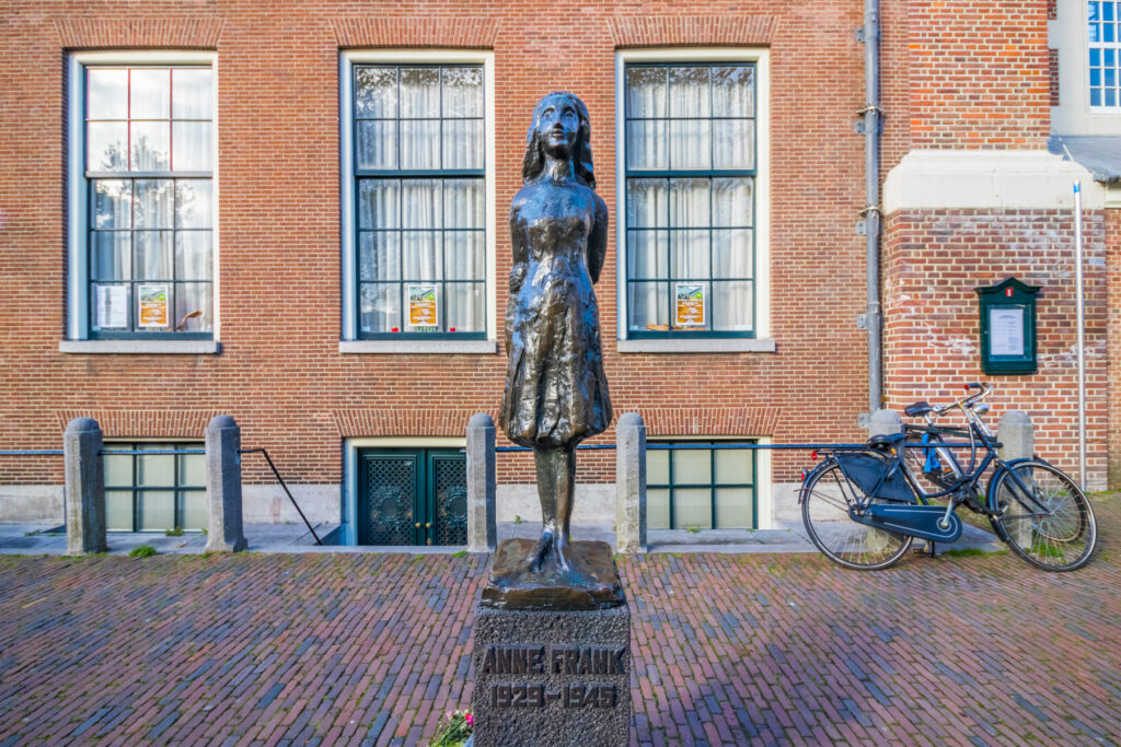 Statue of Anne Frank in front of the Anne Frank House.