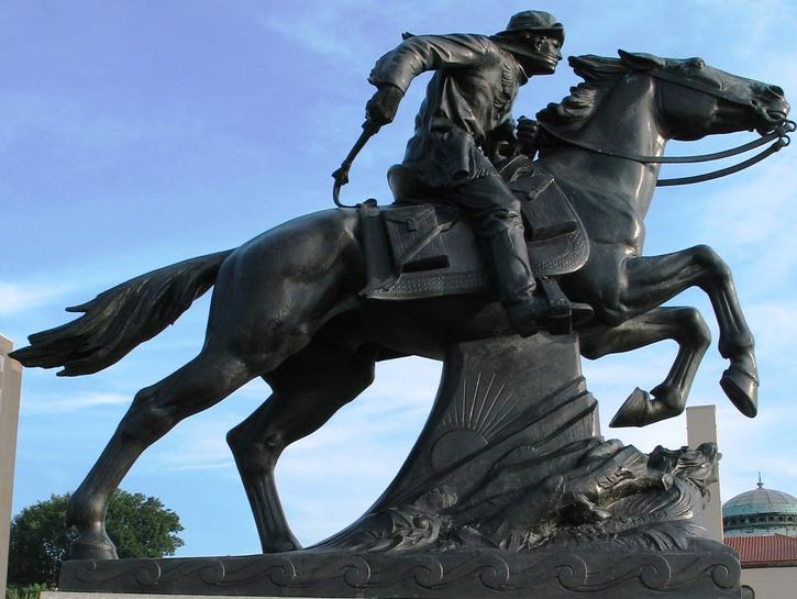 Statue of settler on charging horse