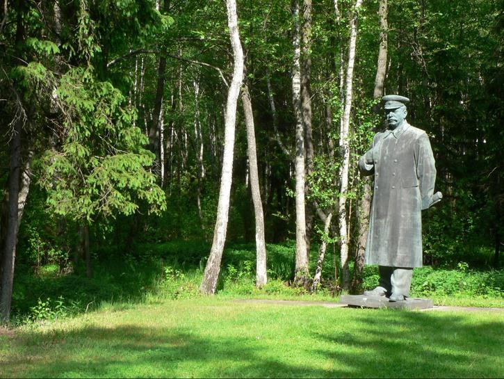 Statue of Stalin near tree line, Grutas Park, Lithuania.