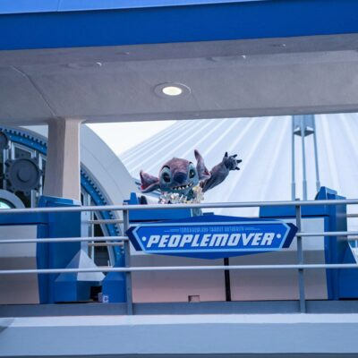 Stitch aboard Tomorrowland Transit Authority PeopleMover.
