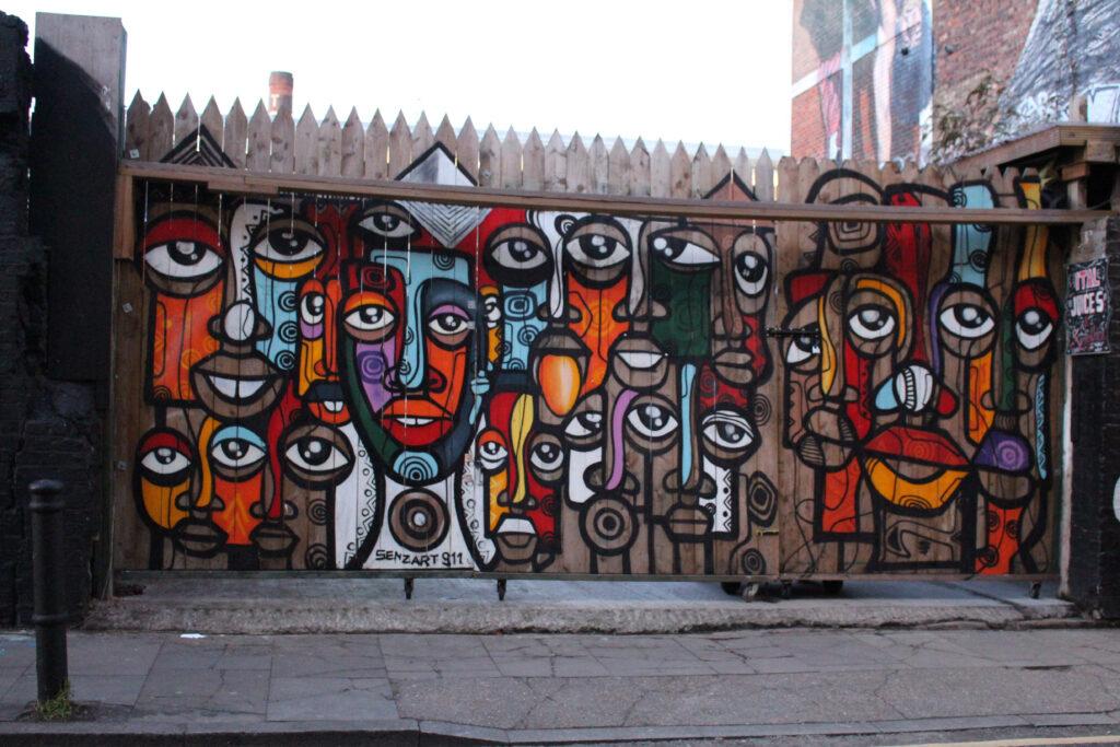Street art by Senzart 911 on Hanbury Street off Brick Lane in London