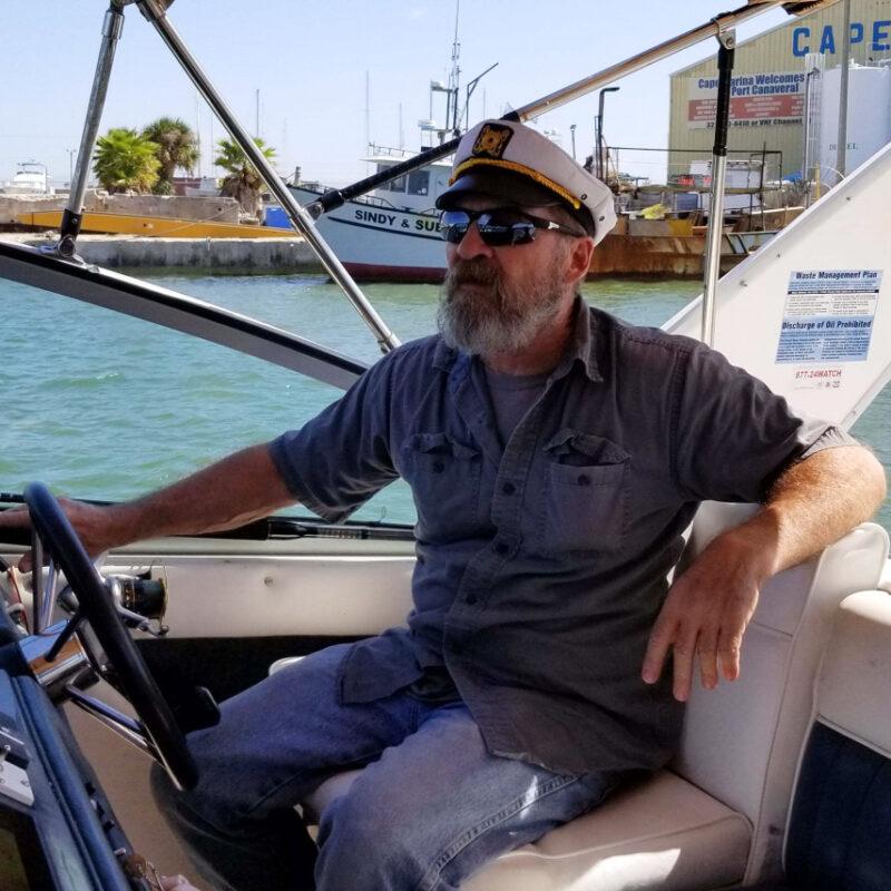 Stuart Bee, 62, navigates his 32-foot Sea Ray through the water.
