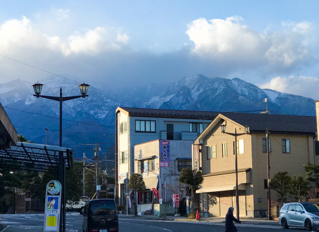 Suburban Nikko, Japan, with snow-dusted mountains in the background