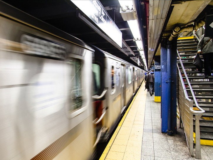 Subway platform with train whizzing past