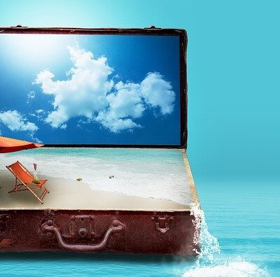suitcase with beach scene