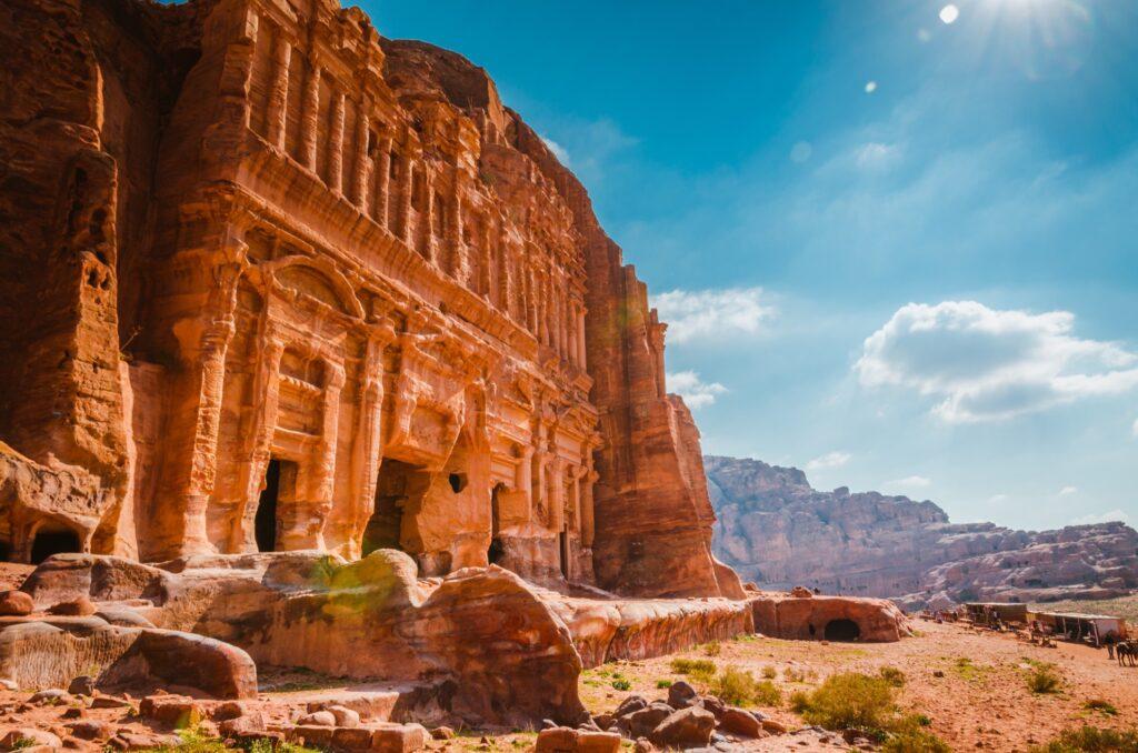Sun shining down on ruins in Petra, Jordan.
