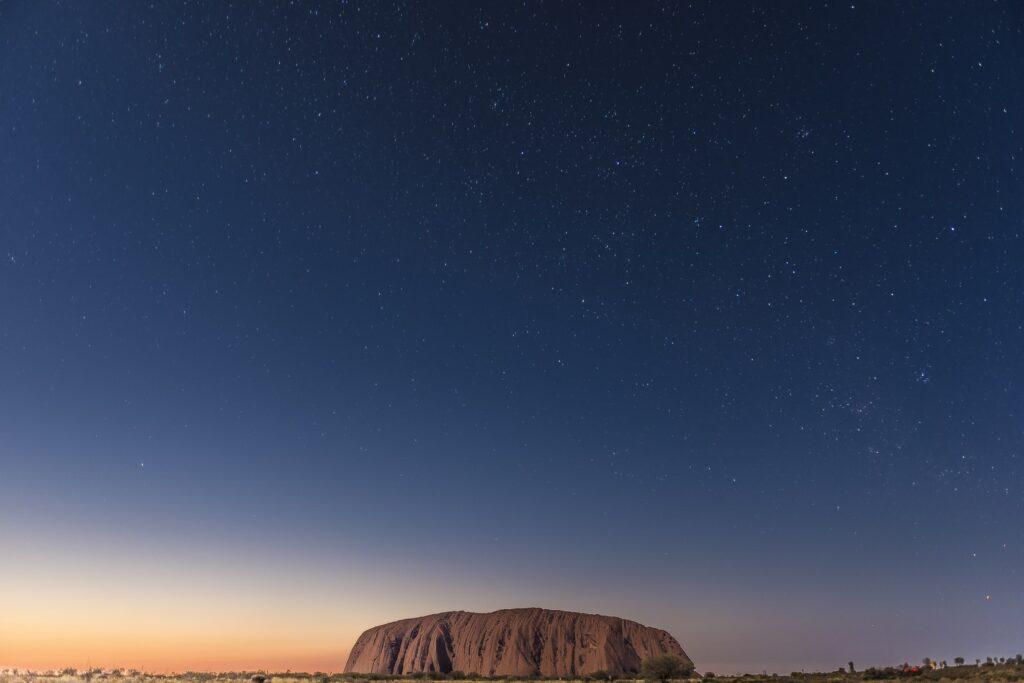 Sunset and starry sky over Uluru
