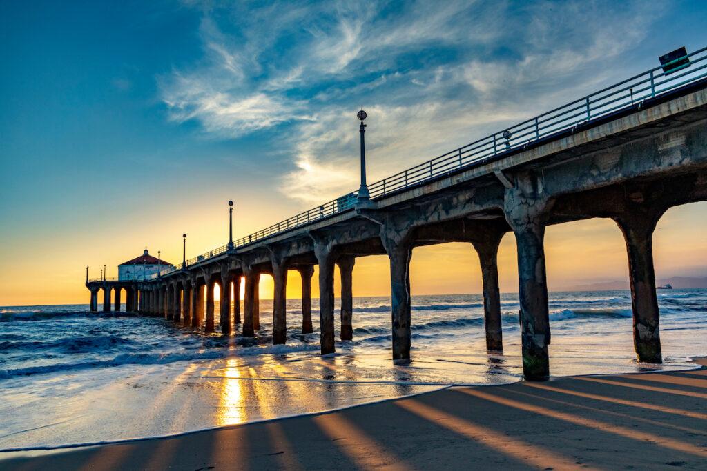Sunset behind the pier in Manhattan Beach, California.