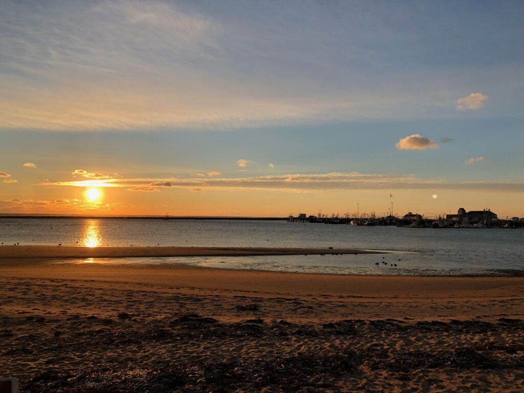 Sunset over a beach in Provincetown.