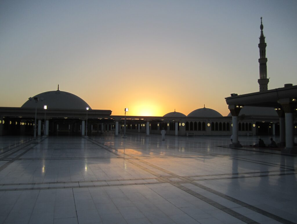 Sunset over marble courtyard of a Saudi mosque.