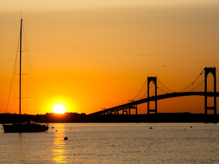 Sunset over Newport with bridge and boat