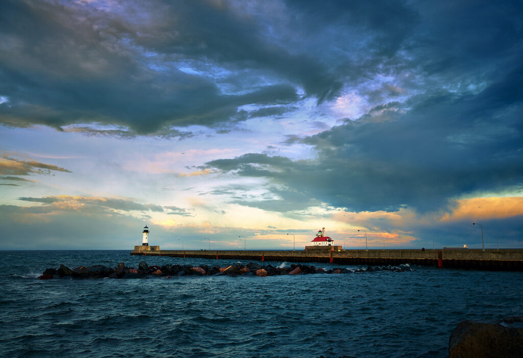 Sunset over North and South Breakwater Lighthouses in Duluth, Minnesota.