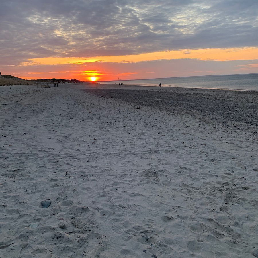 Sunset over Sandy Neck Beach Park in Cape Cod.