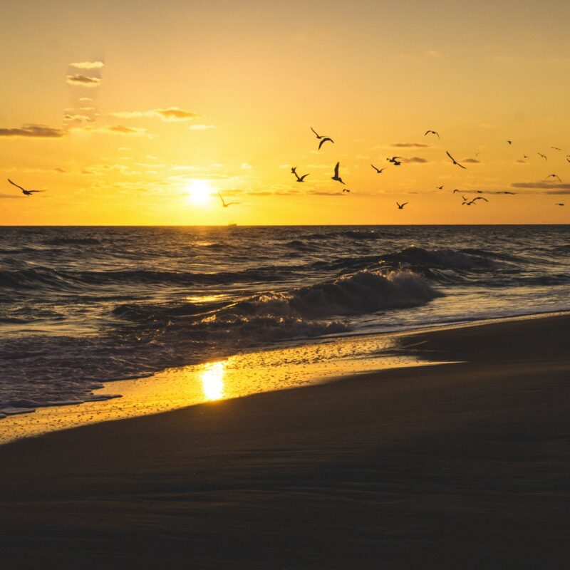Sunset over the beach in Kill Devil Hills, North Carolina.