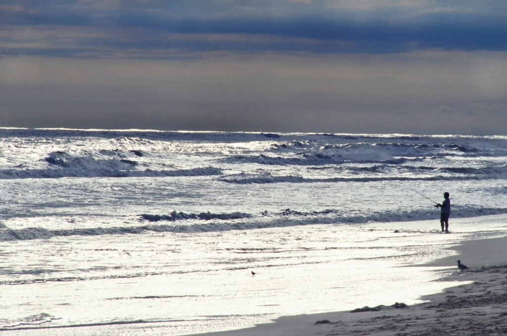 Surf fishing, beach on Ocracoke Island.