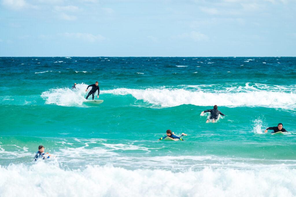 Surfers at Bondi Beach in Australia.