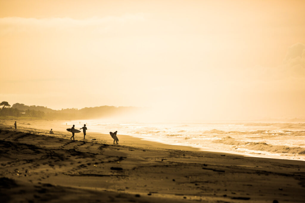 Surfers on a Costa Rican beach.