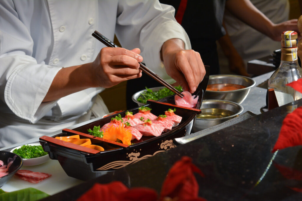 Sushi chef at a restaurant in Japan.