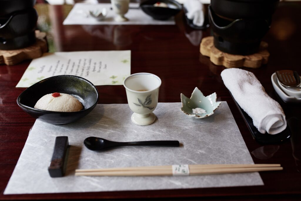 Table setup for a multi-course meal in Kyoto, Japan.
