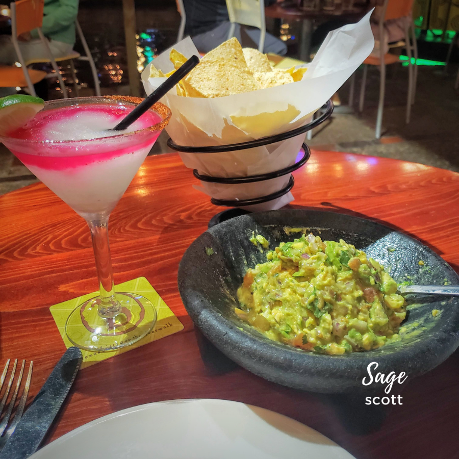 Tableside guac and a cocktail.
