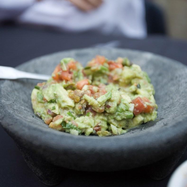 Tableside guacamole in a bowl.