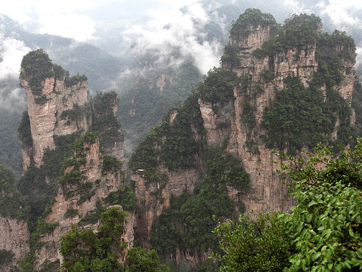 Tall cliffs covered in trees, Wulingyuan, China.