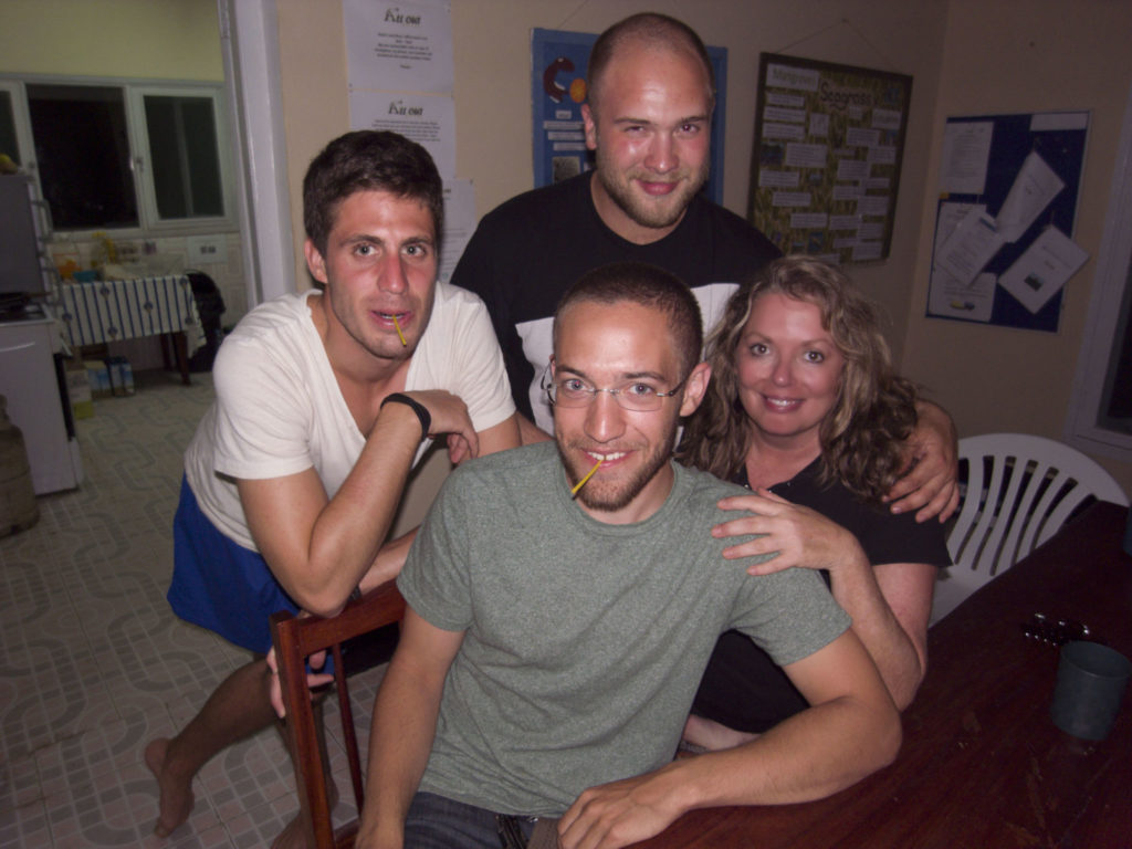 Tam and three other volunteers—all young men