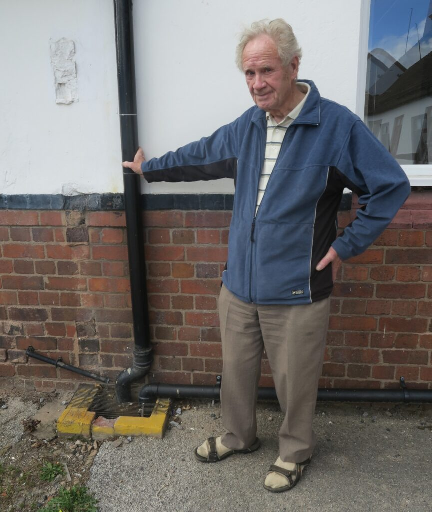 Terence near the old downpipe.