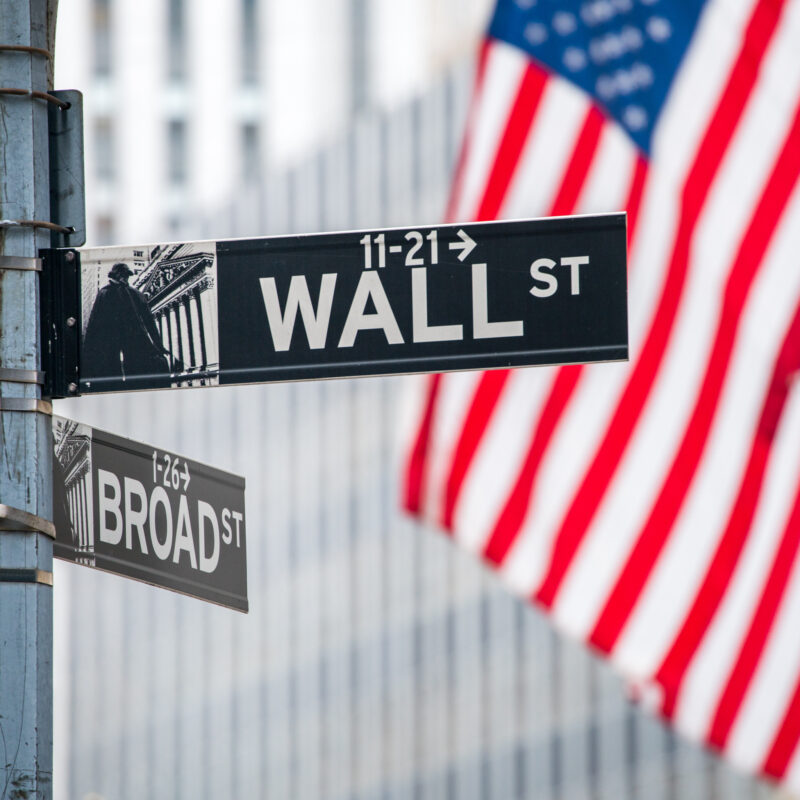 The American flag on Wall Street in New York City.