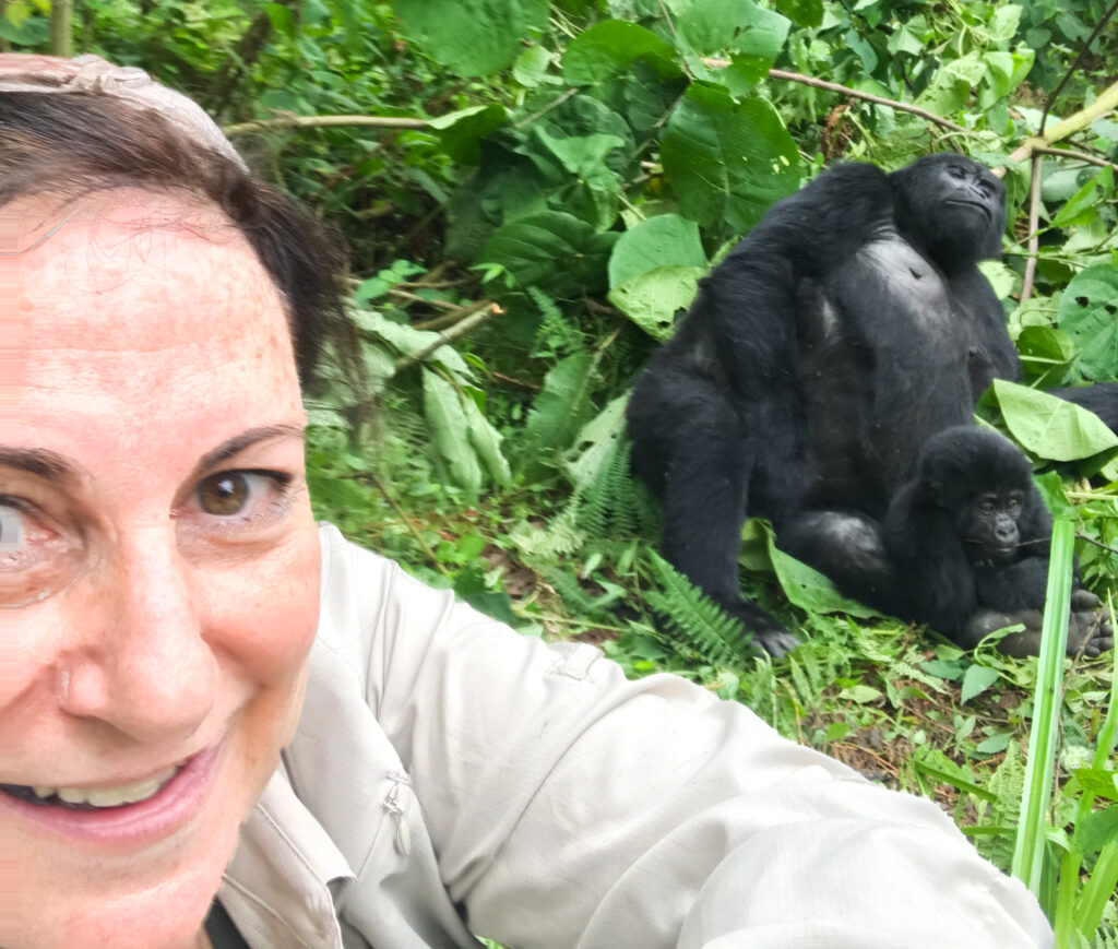 The author taking a selfie with a gorilla.