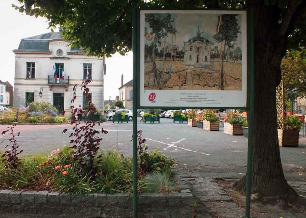 The Auvers-sur-Oise City Hall and a Van Gogh painting.