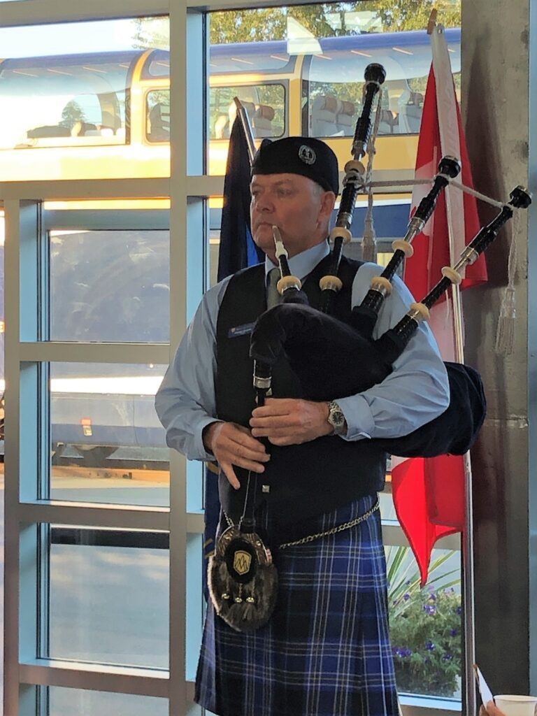 The bagpipe player at the Rocky Mountain Station.