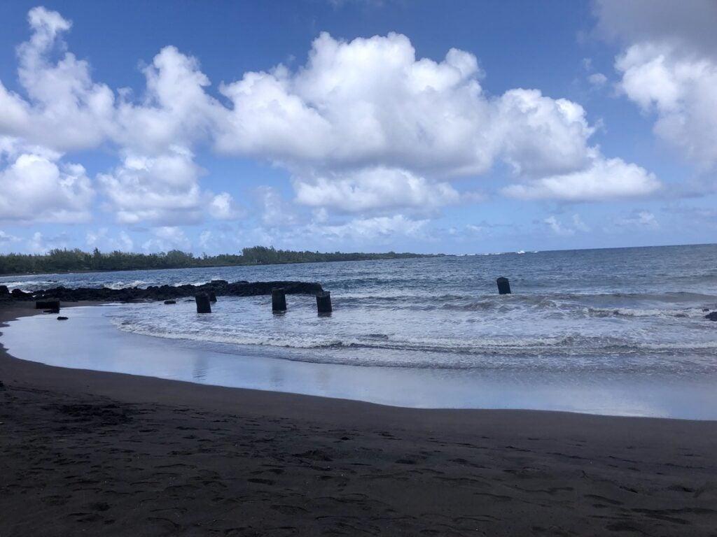 The black sand beach at Hana Bay.