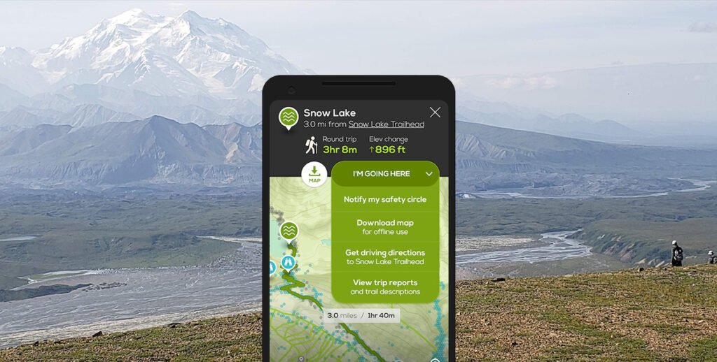 The Cairn app with mountains in the background.