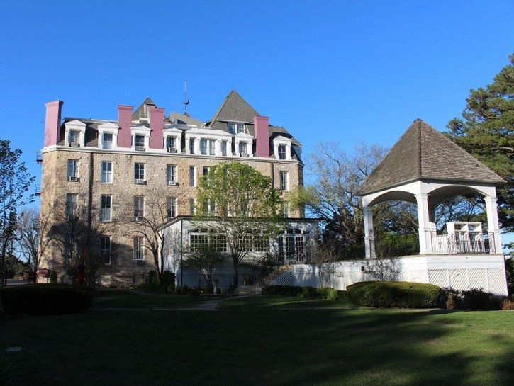 The Crescent Hotel & Spa, seen from the grounds, with gazebo and conservatory