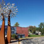 The Dandeblome sculpture on Main Street in Blue Springs.